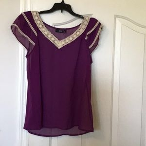 Sexy purple blouse with embroidered neckline.